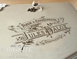 Elegant French Typography Stencil - Blacksmith Forge Advert - preview on the bureau slope