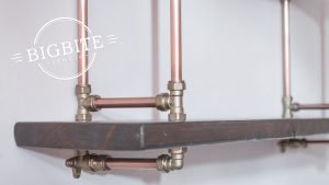 Details of the industrial bookshelf - copper pipes, brass joints and recalaimed wood